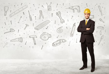 Construction worker planing with hand drawn tool icons on background