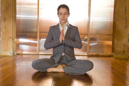 Business Woman In Prayer On Yoga Matt Freestock Photos
