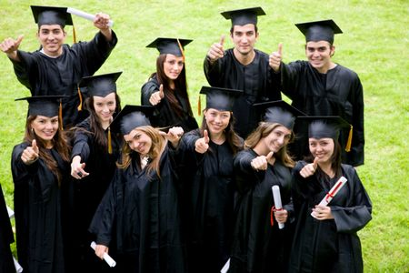 happy graduation students with thumbs up