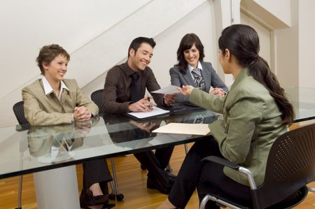 Woman handing over resume at meeting.