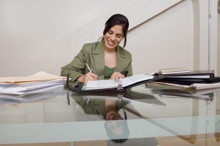 Businesswoman working at desk.