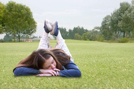 casual girl sleeping on the grass
