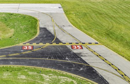 Aviation safety at a glance: Centerlines and other navigational markings by corner of runway at a small civilian airport