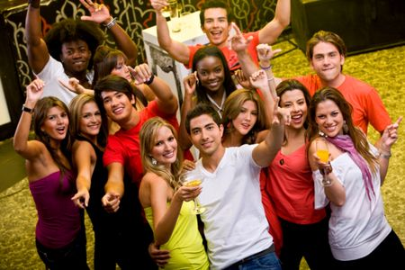 Large group of happy friends at a bar or a nightclub
