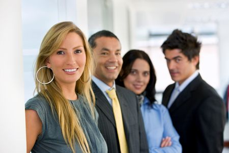 Smiley business team portrait at an office