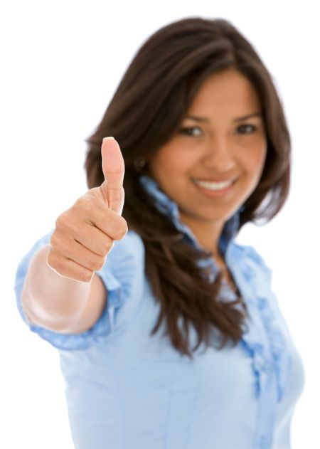 casual woman smiling with her thumbs up - isolated