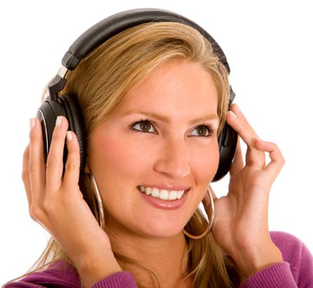 Girl listening to music looking happy - isolated over a white background