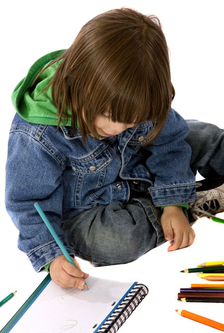 boy colouring on a notebook isolated over a white background