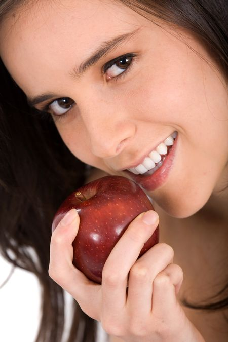 beautiful young girl eating a red apple