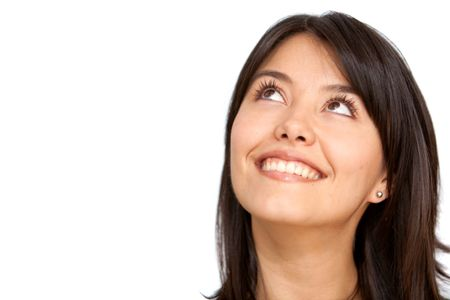 thoughtful woman smiling isolated over a white background