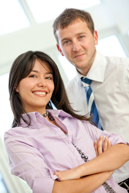 Businesswoman with her partner smiling in an office