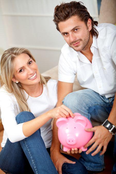 Couple saving money in a piggy bank