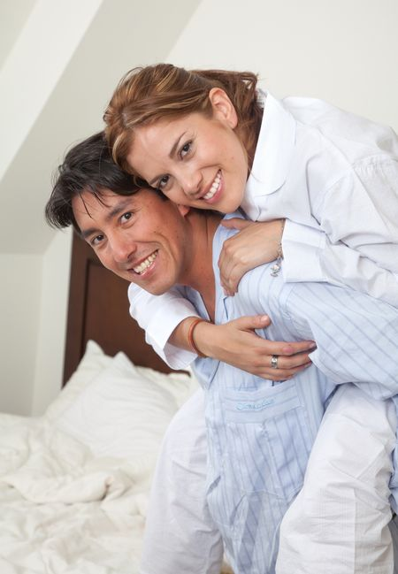 Couple's portrait in their pyjamas of their home