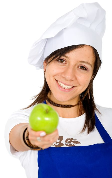 female chef smiling with an apple on her hand over a white background