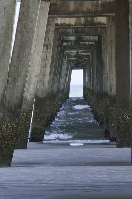 Underside of Jacksonville Beach Pier at low tide