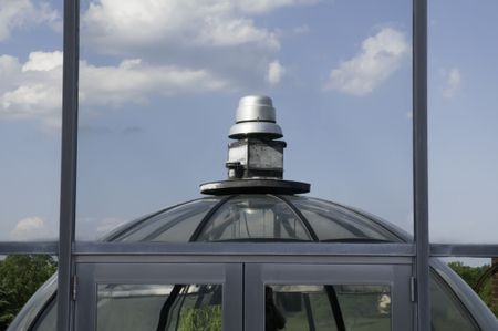 Roof of greenhouse reflected in campus window -- Elgin Community College, Elgin, Illinois