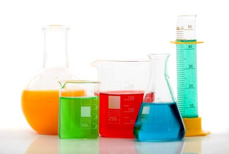 chemistry bottles with different colour liquid inside over a white background