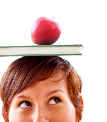 Woman's face with a book and an apple isolated