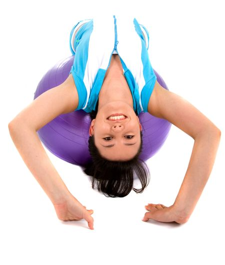 fitness girl doing pilates on a purple ball over a white background