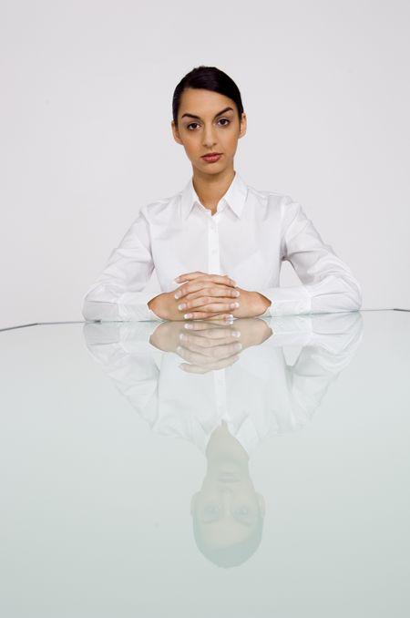 Business woman at end of table.