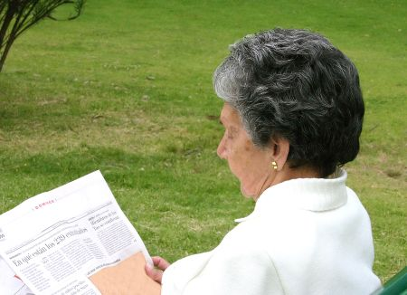 relaxing woman reading newspaper