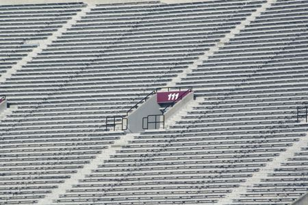 Red gate at college football stadium, telephoto view