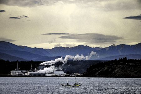 Retro-styled watercolor landscape of paper mill, with plumes of smoke and steam, in Port Townsend, Washington, USA, with Olympic Mountains in background and sailboat in foreground