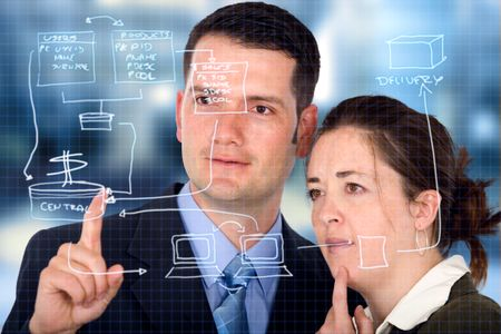 business partners analyzing a database structure in an office