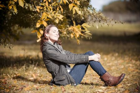 Woman relaxing and resting on the floor on a beautiful autumn sunny day