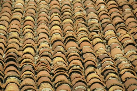 Rows of deep orange terra-cotta tiles on roof