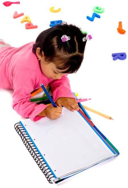 little girl doing her homework on the floor over a white background