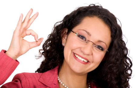 Business woman with glasses doing the ok sign - isolated over a white background