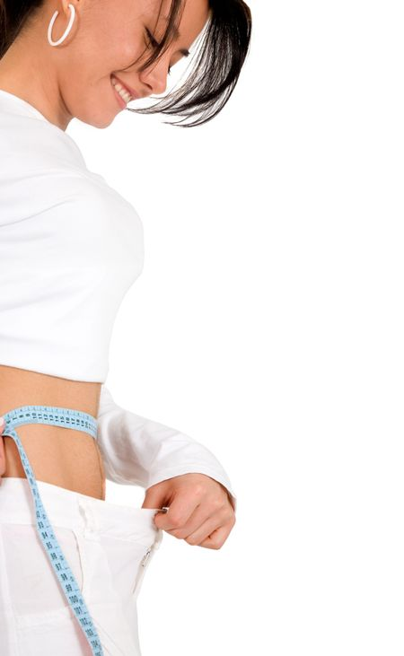 girl on a diet measuring herself isolated over a white background