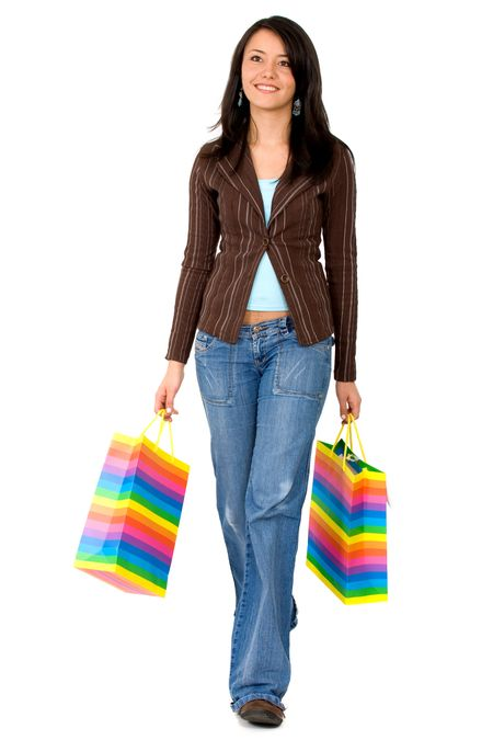casual girl walking with shopping bags isolated over a white background