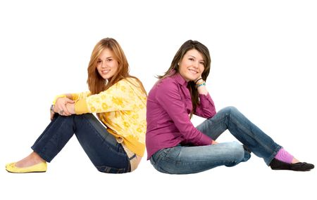 Casual girls sitting on the floor isolated on white