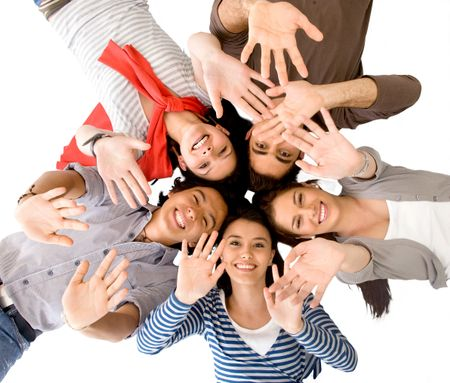 Group of friends with their heads together on the floorwaving isolated