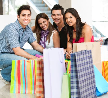 Group of friends with bags at a shopping center