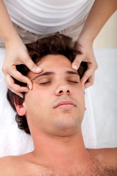 Man getting an anti-stress massage on his face
