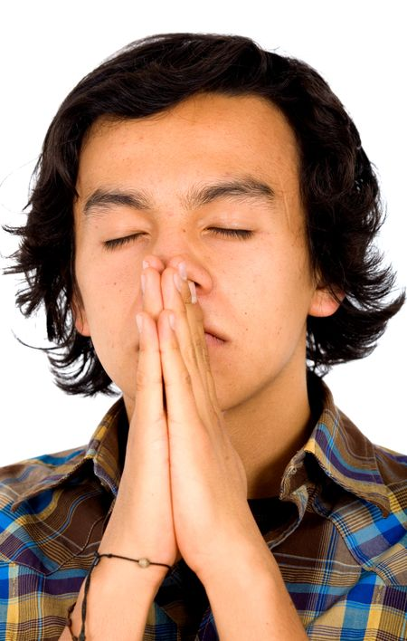 casual man praying with his eyes closed over a white background