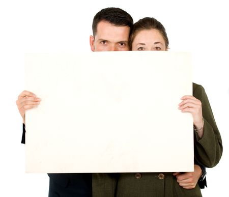 Business parners holding a white card board - isolated