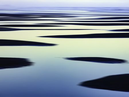Abstract of sandbars and large tide pools on the Pacific coast of Olympic Peninsula in Washington, USA, for themes of nature, repetition, serenity, the environment (one of a series)
