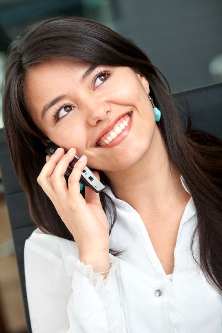 beautiful business woman speaking on the phone