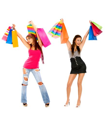 Fashion women with shopping bags isolated over white