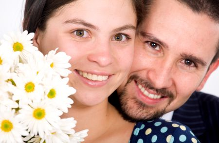 beautiful couple portrait - both smiling with white flowers