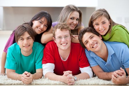 Group of friends lying on the floor and smiling