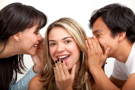 three friends whispering on  isolated white background