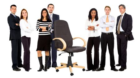 fullbody business group behind an empty chair isolated