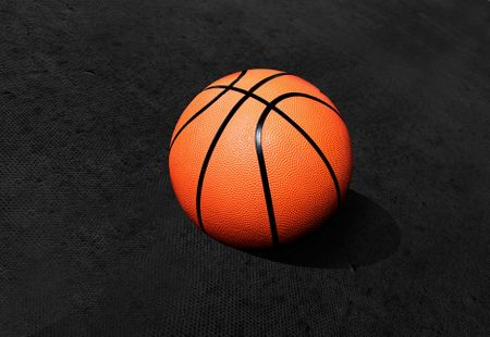 Basketball isolated over a black textured background