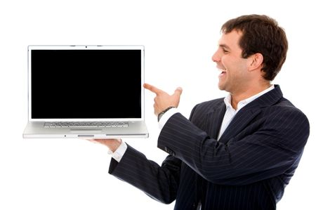 Business man pointing at a laptop computer isolated