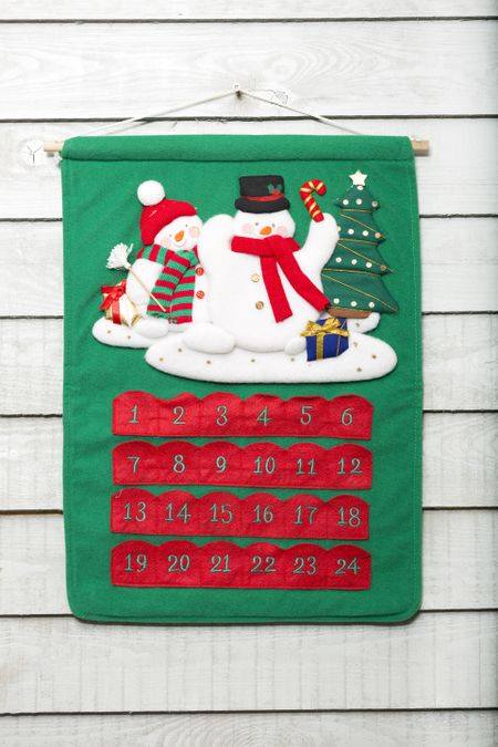 Festive snowman on a Christmas advent calendar
